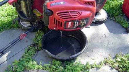how to drain oil from a lawnmower