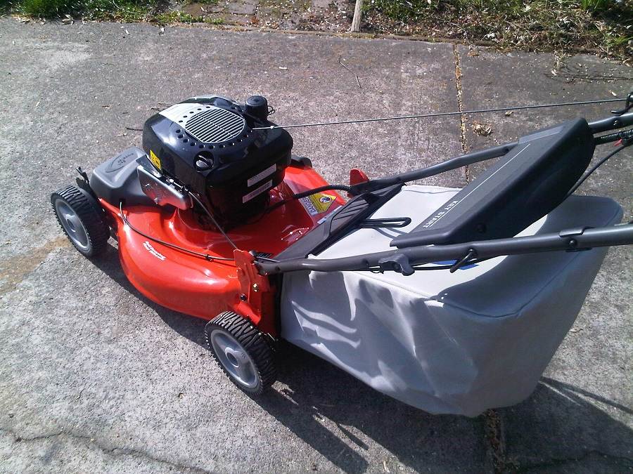 How to remove the gas tank from a Briggs and Stratton lawnmower, step by step 1
